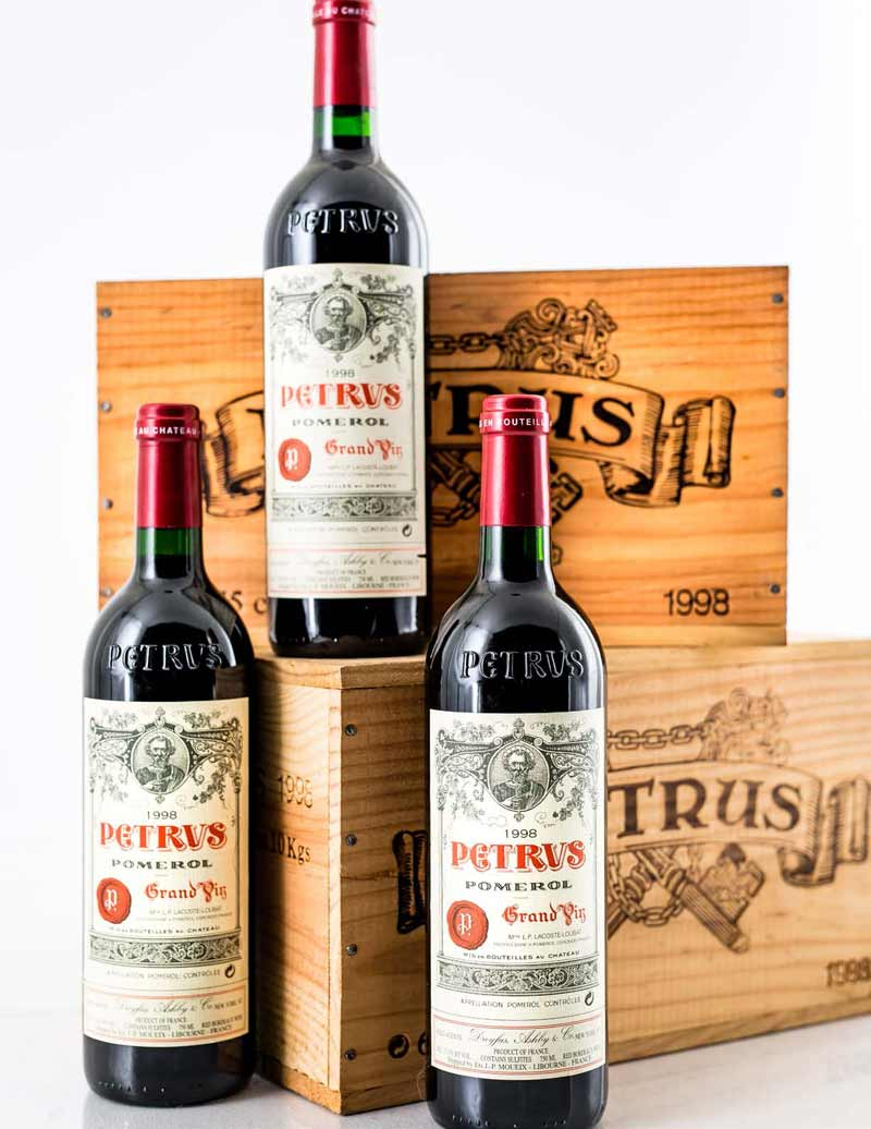 Lot 653: 12 bottles 1998 Chateau Petrus in OWCs